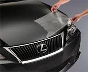 Appying a clear membrane to the hood of a car